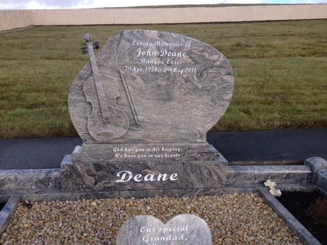 Headstone with carved fiddle rounded kerbing nephin