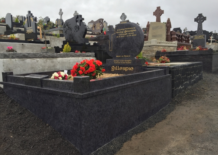 Cross on side headstone complete with plinth and cladding around sides in castlebar cemetery